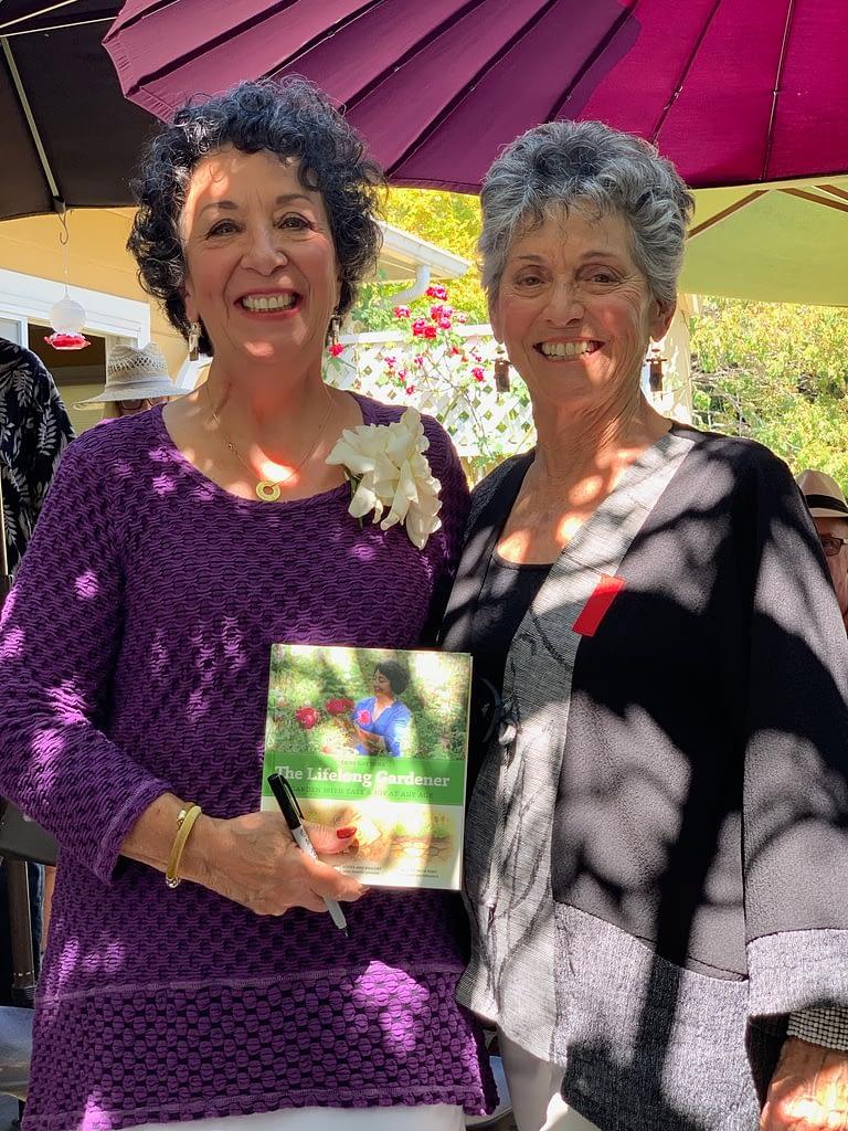 The Lifelong Gardener book contributor, Suki Munsell congratulating author Toni Gattone.
