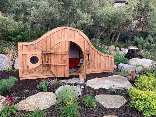 A one-of-a-kind and quite unique hobbit house was a fun surprise to find in the garden.