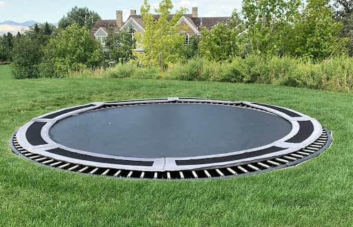 No luxury estate garden tour is complete without a built-in, ground-level trampoline.